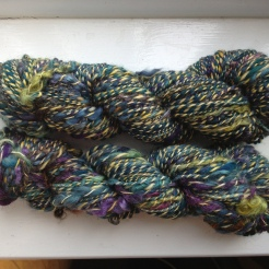 Merino & Wensleydale experiment - Two batts plied together: Homemade batt of merino teal/blue/purple colours and some Wensleydale curls plied with a bit of yellow merino/soy/sparkle blend from Hilltopcloud