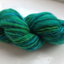 Merino thick/thin skein - A skein created by many hands as family tried spinning over Christmas. Finished by me as thick/thin and fulled when setting the twist. About 50g