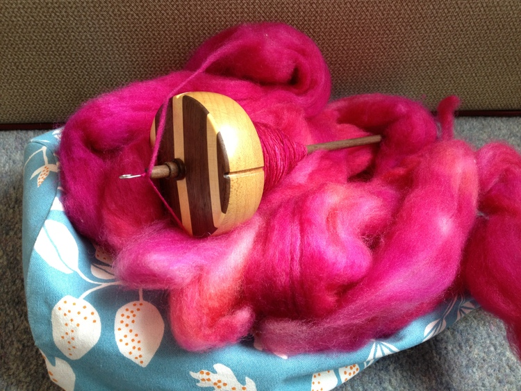My lovely IST Crafts spindle with some pink fluff